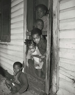 Washington (southwest section), D.C. Negro children in the front door of their home