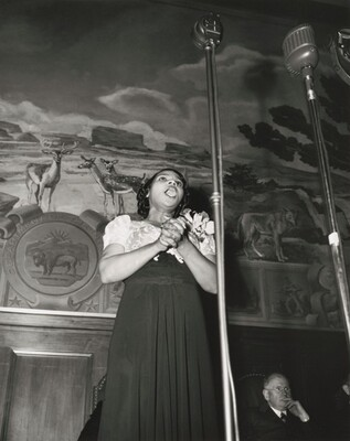 Washington, D.C. Marian Anderson broadcasting a Negro spiritual at the dedication of a mural installed in the United States Department of the Interior building, commemorating the outdoor concert which she gave at the Lincoln Memorial after the Daughters of the American Revolution refused to allow her to sing in Constitution Hall