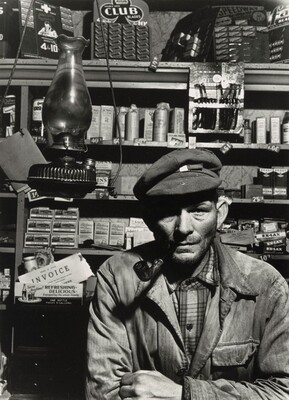 Hercules Brown, 20 year Esso dealer, in his general store, Somerville, Maine
