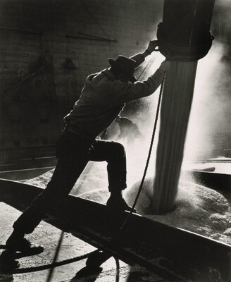 Man Loading Grain Boat