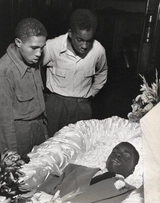In mortuary Red and Herbie Levy study wounds on face of Maurice Gaines, a buddy of theirs who was found dying one night on a Harlem sidewalk