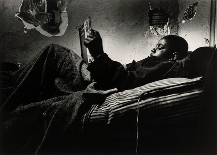 Norman, Jr. Reading in Bed