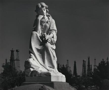 Cemetery Statue and Oil Derricks, Long Beach, California