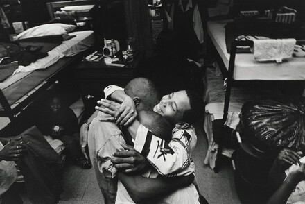 Boys in the shelter hug Pierre Garrett after a tearful confrontation with his mother. Olive Branch Mission, Chicago.