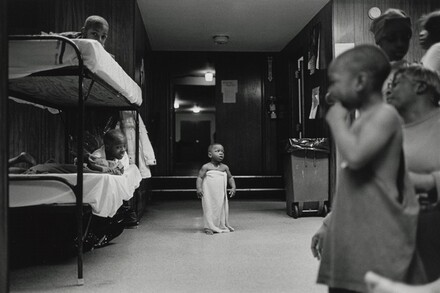 I rarely saw kids in the shelter play. Shelter life is a serious game. This baby waits anxiously for his mama to take him to bed. Olive Branch Mission, Chicago.