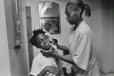 The bathroom at the mission is dreary at best, with holes in the walls and floor, peeling lead paint, no toilet paper, showers without handles. Mothers nevertheless keep their children scrupulously clean, singing praise to God. Here, Renee cleans her daughters face with plenty of elbow grease. Olive Branch Mission, Chicago.