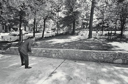 In the front yard of his Atlanta home, Dr. King takes time out for a game of catch with his sons