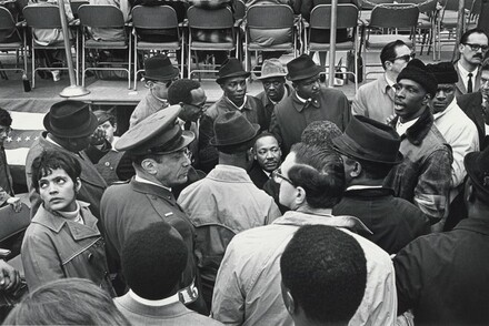 Surrounded by supporters, advisors, and security personnel, Dr. King, Jr. prepares for his speech at the United Nations
