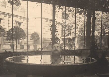 Christian Berard's Head Posed at Edge of Basin of Water, Appearing to Float in the Water at the House of La Vicomtesse de Noailles