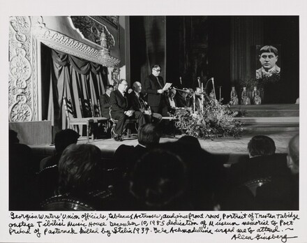 Georgian Writers' Union officials, tableaux actresses, audience front rows, Portrait of Titsian Tabidze onstage Tbilisi Music House December 10, 1985 dedication of Museum memorial to Poet friend of Pasternak killed by Stalin 1937. Bella Akhmadulina urged me to attend.