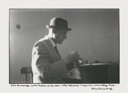 Bill Burroughs with camera in his room Villa Muniria Tangier 1961. His writing desk.