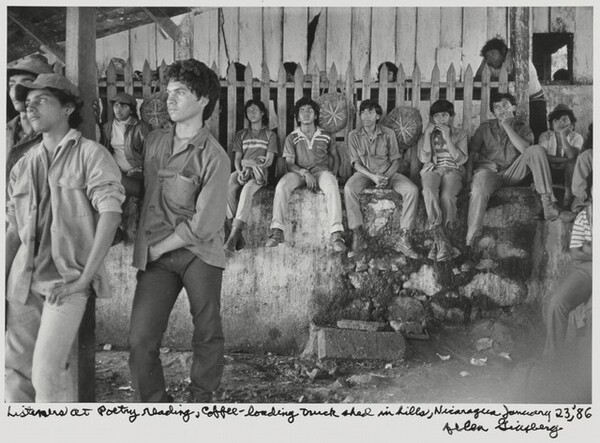 Listeners at Poetry reading, coffee-loading truck shed in hills, Nicaragua, January 23, '86