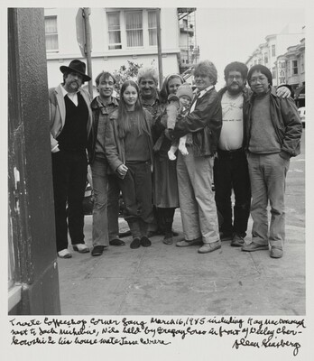 Trieste Coffeeshop Corner Gang March 16, 1985 including Kaye MacDonough next to Jack Micheline, Nile held by Gregory Corso in front of Neeli Cherkovski and his house mate Jesse Cabrera.