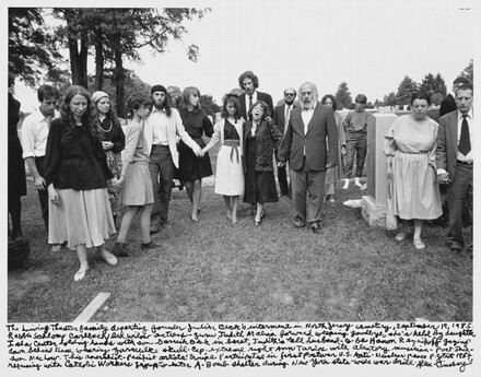 The Living Theater family departing founder Julian Beck's interment in North Jersey cemetery, September 19, 1985. Rabbi Schlomo Carlebach led widow actress- Judith Malina forward weeping goodbye, she's held by daughter Isha center holding hands with son Garrick Beck in beret, Judith's tall husband-to-be Hanon Reznikov gazing down behind them wearing yarmulke skull-cap; extreme right Anne Tardos with aleatory musician- Poet Jackson Machour. This anarchist- Pacifist artists' troupe anticipated in first Postwar U.S. Anti- Nuclear peace protest 1957, refusing with Catholic Workers group to enter A-Bomb shelter during New York state-wide war drill.
