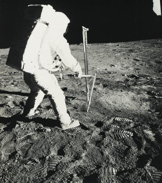 Apollo 11 Lunar Module Pilot Edwin E. Aldrin, Jr. Uses Core Sampler to Remove Lunar Soil Samples...