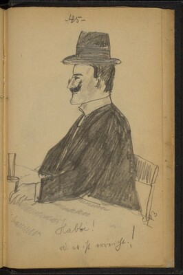 Man Wearing a Hat Seated at a Table