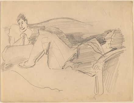 Two Women Lounging on Sofa