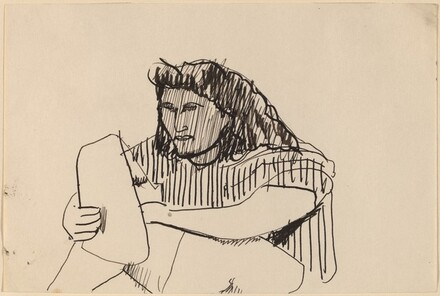 Seated Woman in Striped Shirt Holding Pad of Paper