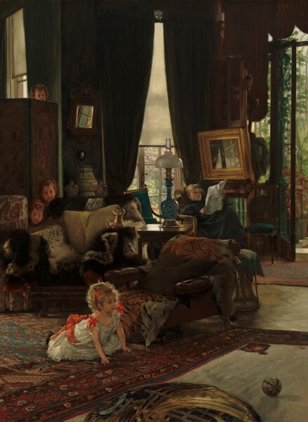 A young girl whose blond curls catch the sunlight in an otherwise dim living room looks up from a kneeling position on all fours on the floor as the faces of three other children peek over pieces of furniture behind her, and a woman leans back in a chair reading a newspaper in the background in this vertical painting. The children and the woman all have peachy, pale skin. The young girl's body is angled to our right and she looks in that direction with eyebrows raised. She has a pointed nose, rounded cheeks, and her rosebud lips are closed. Her mass of blond curls is held back with a scarlet-red ribbon, and more red ribbons are tied into bows at the shoulders of her short-sleeved, white dress and around her waist. Her dress has lacy ruffles down the front and along the bottom hem. She kneels on a large rug patterned densely with burgundy-red, denim blue, and ivory-white stylized flowers, vines, and leaves. A red, blue, and white striped ball rests on a second patterned rug in front of her, to our right. In front of the girl and along the bottom center of the painting is a round but indistinct object, like a flattened basket, that sits on or is part of the carpet. A chocolate-brown, leather chaise lounge behind the girl is covered with at least one tiger's pelt. A wooden side table separates that chair from another overstuffed armchair covered with more furs. Next to it, a third chair with a red paisley pattern against a white background is mostly cut off by the left edge of the canvas. Almost lost in shadow, two small faces peek out from between the two leftmost chairs. Both children have rounded cheeks and they look toward the kneeling girl. The forehead and nose of a fourth child's face peeks over tiny fingers hooked along the top of the screen behind that pair. All three have brown hair pulled back in headbands. Farther back in the room to our right, a young woman with light brown hair, wearing a dark, long-sleeved, high-necked dress, reads her newspaper with her