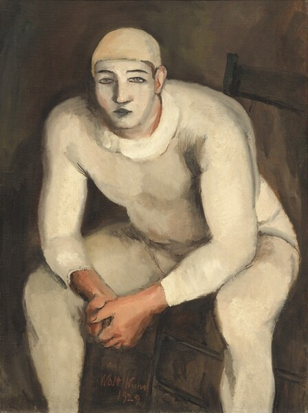 """A stocky, muscular man with his face painted white and wearing a skin-tight, oyster-white costume sits on a wooden chair, leaning forward toward us with his elbows resting on his knees, in this vertical painting. Seen from the ankles up, the man nearly fills the canvas. His body is angled slightly to our left with his knees spread wide, but he looks out at us. He wears a pale, beige-colored cap and his cream-white bodysuit may have a loosely painted, wide collar. His nearly straight eyebrows and closed lips are painted black, and his narrow gray eyes are outlined in black, against the white oval of his painted face. His clasped hands, ears, and his skin visible along the edges of his makeup are pale peach. The background is dark pecan-brown. The artist signed and dated the work with red paint between one of the man's legs and the leg of the chair, near the lower center: """"Walt Kuhn 1929."""""""