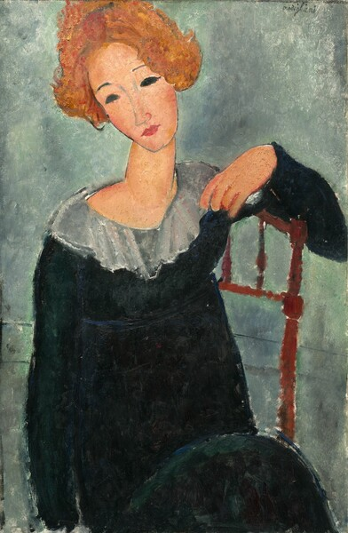 Seen from the lap up, a light-skinned, slender woman, sits leaning sideways against a wooden chair with her head tilted and slightly turned to our left on her long neck in this vertical, stylized portrait. The painting is done mostly with areas of mottled color outlined in delicate black lines. The top of her head and her left elbow, on our right, are slightly cut off by the edge of the canvas. Her ear-length, light red-brown hair is parted in the middle and seems to flip up on the sides, appearing to almost perch over her simply drawn, elongated, oval face. Pencil-thin, nearly straight, grayish eyebrows float above almond-shaped eyes entirely filled in with black. A faint gray line forms her elongated nose. Her small rose pink, pursed lips are slightly darker than the faint blush on her cheeks. Her pale, apricot-colored skin contrasts with the jet black of her simple, long-sleeved dress, which has a high waist and a wide, diaphanous gray collar at the rounded neckline. Her left elbow, on our right, drapes over the top of the spindles making up the back of the chair so her hand rests near the gray collar. Her other arm hangs by her side. The planes of color that make up the form of the woman contrast with the foggy swirl of sage green and elephant gray that form the background. Two faint, thin, parallel, horizontal gray lines that run across the background may suggest a baseboard.