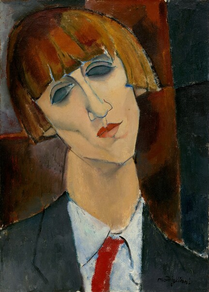 """This vertical portrait painting shows the head and shoulders of a person with pale peach skin and an auburn, cheek-length bob hairstyle. The person has high cheek bones, deep pink lips, and an angular, pointed chin. The head is cocked to our left, and almond shaped eyes are nearly blacked out. The black jacket has wide lapels over a white, collared, button-up shirt with a crimson-red necktie. Shown against brick-red and black background, the portrait is painted with areas of relatively flat color but with loose brushstrokes that a textured, mottled effect. The artist signed the work with black paint in the lower right corner: """"modigliani."""""""