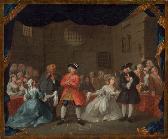 About two dozen elegantly dressed men and women, almost all with pale skin, gather in a room with high, stone walls, with bars over the windows and iron manacles and chains hanging from the wall to our right in this horizontal painting. Most of the people are men, and many wear knee-length, long sleeved jackets, breeches, and stockings, and some wear white wigs. Three men and two women create a loose line across the stone floor, close to us. Near the center, a man stands wearing a coral-red coat with gold colored buttons, navy blue breeches, white stockings, buckled, black shoes, and a black tricorn hat. He faces us with his arms crossed across his chest and his feet planted widely apart. His ankles appear to be manacled. To our left, a woman wearing a long, aquamarine-blue dress with a full, wide, hooped skirt kneels with arms spread wide, a handkerchief in one hand, in front of an older, portly man who leans away from her, one hand raised above skeleton keys that hang from that wrist. To our right, a woman wearing a full, white, satin dress kneels facing us and looks up toward a man wearing a black coat and hat, with white at the neck, cuffs, and white stockings. A sword hangs at his side. He holds up one hand, palm out, towards the woman in white. Both women wear pearl necklaces and white lace caps. The remaining people gather around the perimeter of the scene behind a low, brick-red wall. The head and shoulders of a boy with brown skin peeks out of the box near the man with the sword, to our right. The scene is surrounded by a band of gold and by a cobalt-blue, gold-edged curtain that flutters along the top and drapes down each side to puddle on the floor.