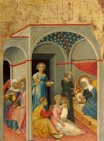 Under an arched structure, five women gather around a baby as two men sit outside the room in this vertical painting. All the people have pale skin with a faintly greenish cast. The women have blond hair and the men have gray hair. To our right, a ruby red curtain has been drawn back along the long side of a bed, and a woman there reclines propped on one elbow, facing into the room. She wears a white veil that covers her hair, neck, and shoulders and a sky blue robe edged with gold over a navy blue dress. Her head is encircled with a gold halo and she looks down toward the baby at the center of the painting. Her wrists are crossed over a gold bowl and an attendant standing next to the bed pours water from a gold pitcher over her hands. The attendant wears a forest green dress and a white cloth is wrapped over her head. A pair of women sitting on the floor near the bed hold the infant, who has a gold halo around short-cropped, blond hair. Wrapped in a white cloth, the baby stands on the lap of one woman, who wears a rose pink dress and a white cloth wrapped around her hair. The second woman in this pair, to our left, wears a golden yellow robe over a scarlet red dress, and her braided hair is wrapped around her head. She holds both hands up in front of the baby, who looks toward her, facing our left in profile. A gold bowl with a flaring foot sits on the floor in front of this trio. Coming through a darkened doorway behind them, a fifth woman wearing a topaz-blue dress enters carrying a gold dish. To our left, two bearded men sit with their backs to the gray, stone wall enclosing the room with the women. The man closer to us has a long gray beard, and his wavy hair is surrounded by a gold halo. He looks to our left in profile and wears a rose pink robe edged with gold, over a light blue garment. The second man angles his body toward him and gestures toward the haloed man with one raised finger. The second man has a trimmed, gray beard and he wears a slate blue robe o