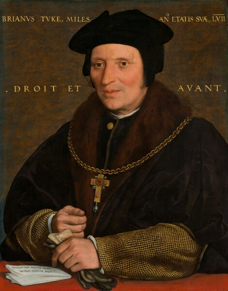 """Shown from the waist up, a middle-aged, cleanshaven man wearing a black cap, a voluminous fur-lined, black cloak, and a garment with wheat-gold-and-black sleeves is positioned behind a crimson-red ledge or tabletop in this vertical portrait painting. His head and torso nearly fills the composition. His body is angled to our left and he looks off in that direction with dark brown eyes under faint eyebrows. His high cheeks, closed lips, and pointed nose are a rosy, peach color, and he has the faint hint of a five o-clock shadow. His soft black cap has flaps that cover his ears. The wide, fur lapels of his black cloak nearly reach his shoulders. The sleeves of the garment beneath has a tight, tan-and-black checked pattern, and a white undershirt peeks out at his neck and cuffs. A cross hanging from a heavy gold chain has black pearls in the cross of each arm and a teardrop-shaped black pearl hangs from the bottom. The cross appears to be painted with a hand on each short arm, two feet on the long leg, and a red circle at the center. The sitter's left hand, on our right, rests on the red surface holding a pair of gloves that are ivory around the wrist and charcoal gray at the fingers. His right hand, father from us, rests in a loose fist near his other wrist. A folded piece of white paper with black writing lays to our left of the hands. It reads, """"NVNQVID NON PAVCITAS DIERVM MEORVM FINIETVR BREVIS."""" The background behind the man is mottled with rust-brown and steel-gray. Gold writing spans the background to either side of the man's head, reading, """"BRIANVS TVKS, MILES, ANO ETATIS EVAE LVII"""" along the top and """"DROIT ET AVANT"""" across the center."""