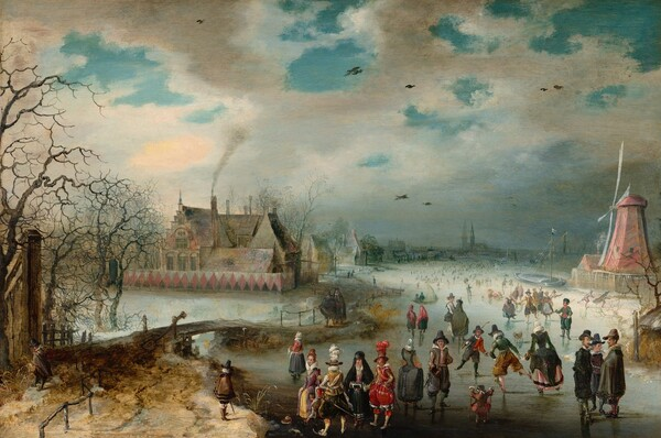 We look slightly down onto a scene showing light-skinned men, women, and children ice skating on a frozen river in this horizontal landscape painting. We get the impression of hundreds of people gathered on the ice creating a crowd that extends into the hazy distance. The couple dozen closest to us are the most defined. A few clusters of people and individuals draw our attention. For example, a group of three men wearing dark cloaks and hats stand in conversation on our right. Two boys nearby hold sticks and appear to play a game similar to hockey. A small child holds two smaller sticks, perhaps to help balance. A man in the front center wears billowing scarlet red pants with white stockings, a red jacket, and a tall brown hat with a cloud of scarlet feathers. He stands next to a woman wearing a black hooded cloak over a black skirt and raspberry pink bodice. She holds a cylindrical muffler at her waist to keep her hands warm. Another elegantly dressed man in golden yellows and black and a woman in mauve and butter yellow stand nearby. Some of people throughout the scene wear white frilly collars and others are more simply dressed in browns, grays, and black. To our right, a faded rose-red windmill stands at the river's edge and to our left, a large house with steeply pitched and stepped roofs is enclosed within a fence painted with pink diamonds against black and white. Smoke rises from one chimney and other houses and a church line the riverbank into the distance. A wooden bridge near a grove of bare trees connects spit of land near us in the lower left corner with the village beyond. Brilliant azure blue sky is visible through breaks in the steely clouds above.
