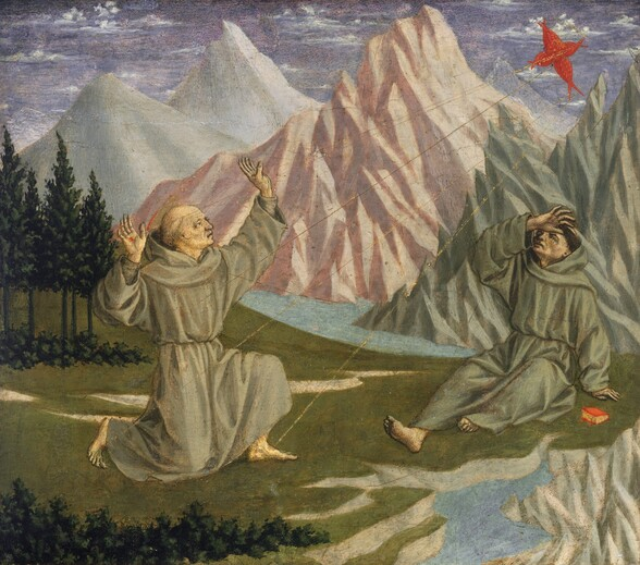 In a landscape with chiseled, rocky mountains beyond a grassy meadow and stream, one of two men wearing dove-gray monk's robes kneels and holds his hands up towards a flame-red cross shape in the sky that hovers over the second man, who sits and leans back on the grass with one hand to his forehead in this nearly square painting. Both men have pale complexions. Their loose robes are cinched at the waist and both have bare feet. The man to our left, with hands raised, kneels with his body angled to our right, facing the flame-like cross in the sky. He has a flat gold halo edged with red. Five thin gold lines emanate from the red cross to touch the man's hands, feet, and the right side of his chest. There is a red spot where one gold ray touches the palm of his right hand, closer to us. The second man to our right sits and leans back on one hand, and holds his opposite hand to his brow as he looks up toward the cross. He has dark hair cut into a ring that encircles his head. A small book with yellow pages and a scarlet red cover sits on the grass nearby. In the background, each of the three tall, pointed mountains nearly touch the top edge of the composition, and each is a different color, with icy, pale blue to our left, shell-pink at the center, and light turquoise to our right. A stream running along in front of the mountains turns a corner and comes our way in the lower right corner of the panel. The green meadow has a line of dark pine green trees and bushes behind the kneeling man and along the bottom left edge of the panel, near us. Wisps of white clouds float in the violet sky above.