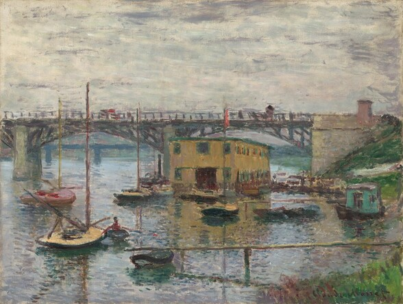We seem to stand on a high hill or hover slightly above a riverbank, looking across a glimmering river towards docks, about a dozen small boats, and a mustard-colored, boxy building under a bridge that crosses the width of the canvas in this horizontal landscape painting. A patch of green grass lines the riverbank in the lower right corner of the canvas. The land curves away out of sight, and then back into the scene below the abutment of the bridge along the right side of the painting. From the ivory-colored abutment, the straight deck of the bridge is supported by two shallow, iron-colored arches, and the bridge extends off the left side of the composition. Dots of red and gray on the bridge suggest vehicles or pedestrians. The river below is painted with blended strokes of silvery-gray, icy blue, and pale lavender purple around the low-sided sailboats. One turquoise colored houseboat is pulled up to the riverbank to our right. The long, rectangular, flat-topped building is pierced with two stories of windows, which are outlined in spruce-green against the golden yellow. The horizon line runs just below the bridge deck, just under halfway up the composition. The sky above is painted with longer swipes of cream-white and smoke-gray. Loose, short brushstrokes are visible throughout, especially in the water, boats, and bridge.