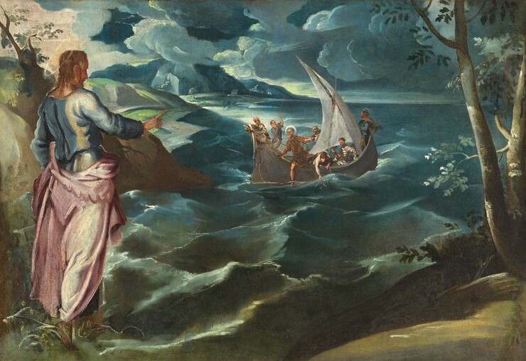 A man stands at a coastline with his back to us, gesturing toward a group of seven men sailing on the rolling sea in this horizontal painting. All the people have pale white skin. The man standing near us to our left wears a light blue tunic under a shell pink garment that drapes around his hips and falls to his ankles. A thin gold halo encircles his head over curly brown, shoulder-length hair. Green land extends along the foreground close to us, and trees rise to either side. It is unclear whether the man stands on the land or on the water with bare feet. His body is angled away from us and to our right as he looks and gestures with one arm raised towards the boat on the water beyond.  Choppy waves and swirling, dense clouds ranging from topaz to navy blue dominate the landscape. Each of the seven men in the sailboat does something different. For instance, one leans over the edge to grasp a fishing net while another pulls a rope for the sail. Two of the men have white halos. One stands at the back of the boat looking into the far distance and the other begins to step onto the surface of the water.