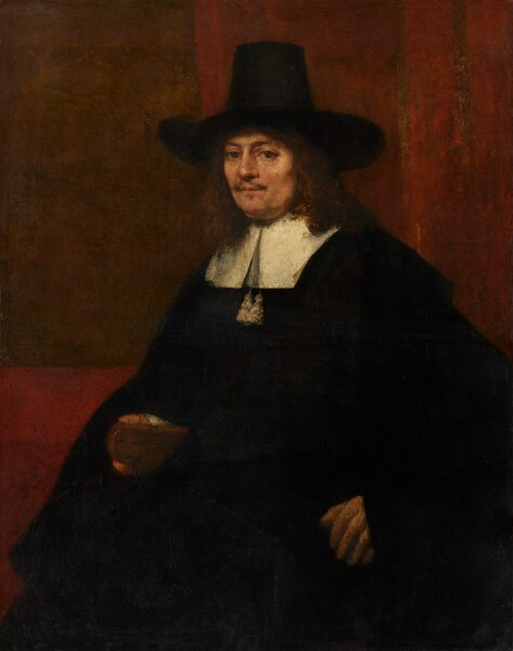 Shown from about the knees up, a middle-aged, fair-skinned man wearing a voluminous black cloak and a tall, brimmed hat looks directly at us in this vertical portrait painting. His body is angled to our left and he turns his face to look at us with brown eyes. He has a wispy, brown mustache over his pale pink lips, which are closed. He has a slight double chin and his reddish-brown hair falls to his shoulders. His wide, brimmed hat has a tall crown, which tapers a bit near the top. His black cloak falls over his arms and body, and has a wide, flat, white collar. Two white tassels hang below the split down the front of the collar. His left hand, to our right, seems braced against the arm of a chair we cannot see, and he holds a brown object in his other hand. The object is loosely painted but could be a low mug or a small book. The wall behind him is brick-red with a coffee-brown rectangle to our left. Two vertical, fawn-brown stripes run down the red wall to our right, behind the man. Brushstrokes are visible in some areas, as in the man's face, and a network of cracks runs across the surface of the canvas.