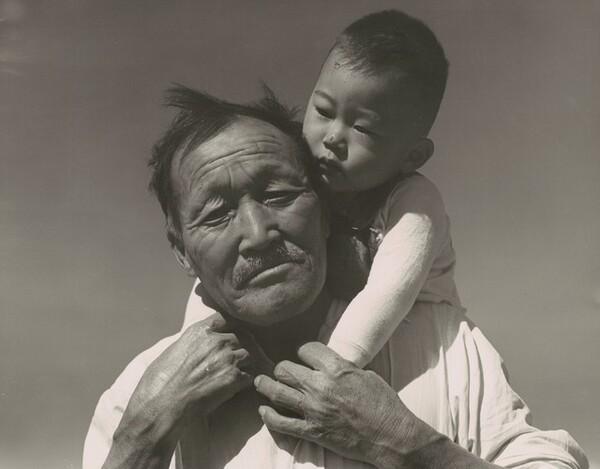 Grandfather and grandson of Japanese ancestry at a War Relocation Authority center, Manzanar, California