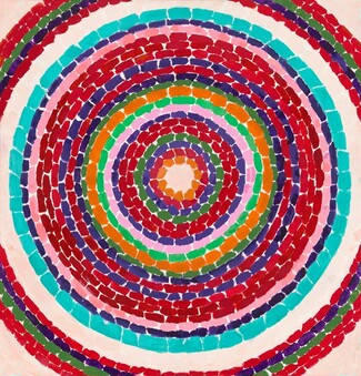 This nearly square, abstract painting is filled with circles within circles, like nested rings, each of a single bright color against the ivory color of the canvas. Each ring is made up of a series of short, rectangular strokes and some bands are narrower while others are a bit wider. The majority of the rings are crimson and brick reds, and they're interspersed with several bands of lapis blue, two army green rings, and two pale pink rings. The single pumpkin orange band is the smallest, innermost ring at the center. There is one aqua colored ring just inside the lone white ring, which is the first to get cut by the edges of the canvas. A few red, green, and blue rings beyond the white band are only seen at the corners of the canvas.