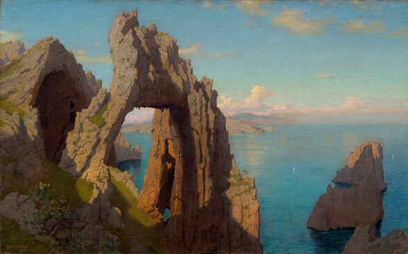 We look across and slightly down onto a rocky, natural stone arch next to a cave opening, both perched on a high, grassy cliff in front of a shimmering, aquamarine-blue body of water in this horizontal landscape painting. The arch is situated to our left of center, and the cave beyond the gaping opening extends off the left side of the canvas. In tones of ash and caramel brown, the jagged arch and outcroppings are lit from our left so deep shadows are cast along crevasses to our right. Shadow also sweeps across the emerald-green grass at the base of the arch and cave. A few more serrated rocks poke out of the water like teeth far below, to our right, presumably at the base of the cliff on which we stand. To our left, the rocky shoreline juts into the water in the distance in front of mauve-colored mountains in the deep distance along the horizon, which comes about halfway up this composition. Tiny in scale, miniscule, triangular white sails dot the waterway. Similarly tiny white birds fly high above the water. Pale, petal-pink and cream-white clouds line the horizon beneath a sky that deepens from light turquoise over the clouds to the same aquamarine blue of the water below.