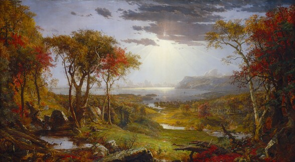 """We look out onto a sweeping, panoramic view with trees, their leaves fiery orange and red, framing a view of a distant body of water under a majestic sky in this long, horizontal landscape painting. The horizon comes about halfway up the composition, and is lined with hazy mountains and clouds in the deep distance. Closest to us, vine-covered, fallen tree trunks and mossy gray boulders line the bottom edge of the canvas. Beyond a trickling waterfall and small pool near the lower left corner and tiny in the scale of the landscape, a group of three men and their dogs sit and recline around a blanket and a picnic basket, their rifles leaning against a tall tree nearby. The land sweeps down to a grassy meadow crossed by a meandering stream that winds into the distance. A low wooden bridge spans the stream to our right, and a few cows drink from the riverbank closeby. Smoke rises from chimneys in a down lining the riverbank and shoreline beyond, and tiny white sails and steamboats dot the waterway. Light pours onto the scene with rays like a starburst from behind a lavender-gray cloud covering the sun, low in the sky. Close examination slowly reveals miniscule birds tucked into the crimson red, golden yellow, and deep sage green leaves of the autumn trees, dabs of white and gray that represent a flock of grazing sheep in the meadow, and people on horseback and foot in the landscape beyond. The artist signed the painting as if he had inscribed the flat top of a rock at the lower center of the landscape with his name, the title of the painting, and date: """"Autumn – on the Hudson River, J.F Cropsey, London 1860."""""""