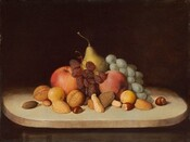 "Several pieces of fruit, bunches of grapes and raisins, and several types of nuts in their shells are piled in a pyramidal form on a round, cream-colored, possibly wood tabletop against a dark background in this horizontal still life painting. The food is brightly lit from the front, and the tabletop seems to tip slightly down. There are two round red apples and two pieces of small yellow fruit, perhaps quinces, flanking a golden yellow pear at the back center. The bunch of green grapes drapes over the fruit to our right and the bunch of raisins is propped between the apples. Thirteen walnuts, peanuts, almonds, hazelnuts, and perhaps a brazil nut are scattered in a loose band in front of the fruit. The surface on which the still life sits becomes swallowed in shadow behind the fruit, and blends into the dark brown background. The artist signs and dates the work in dark paint in the lower right corner, almost lost in shadow under the table ledge: ""R.S. Duncanson 1848."""