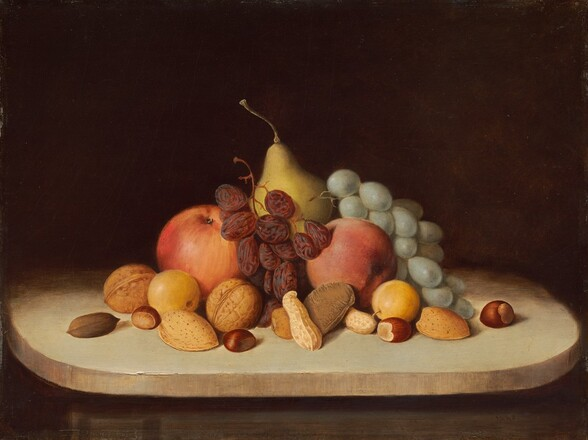 """Several pieces of fruit, bunches of grapes and raisins, and several types of nuts in their shells are piled in a pyramidal form on a round, cream-colored, possibly wood tabletop against a dark background in this horizontal still life painting. The food is brightly lit from the front, and the tabletop seems to tip slightly down. There are two round red apples and two pieces of small yellow fruit, perhaps quinces, flanking a golden yellow pear at the back center. The bunch of green grapes drapes over the fruit to our right and the bunch of raisins is propped between the apples. Thirteen walnuts, peanuts, almonds, hazelnuts, and perhaps a brazil nut are scattered in a loose band in front of the fruit. The surface on which the still life sits becomes swallowed in shadow behind the fruit, and blends into the dark brown background. The artist signs and dates the work in dark paint in the lower right corner, almost lost in shadow under the table ledge: """"R.S. Duncanson 1848."""""""
