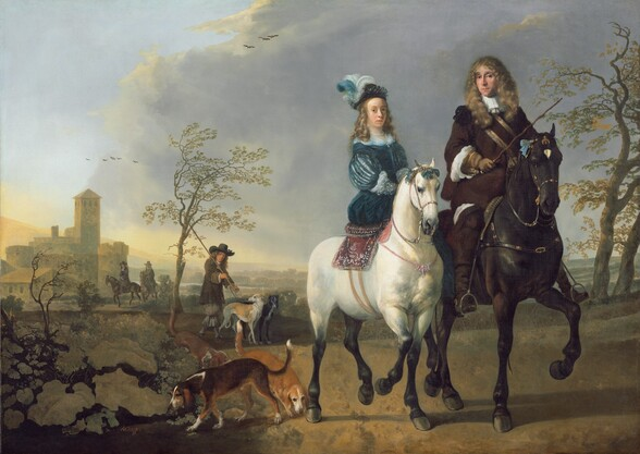 An elegantly dressed man and woman ride horses that seem to walk toward us and to our right in a landscape with low, rolling hills, stone buildings, and trees in this horizontal painting. The two horses and riders take up the right half of the composition. Both people have pale skin and look at us. The woman has a high forehead, a straight nose, a round face, and curly blond hair falling to her shoulders. She wears a sapphire blue dress with ornamentally slashed sleeves to reveal a white garment below. Her hat is adorned with blue and white feathers and she wears a string of pearls around her neck. The legs of her white horse darken to black below the knees, and the bridle is tied with blue bows near the horse's ears. The sidesaddle sits on a woven, rug-like blanket. Next to her, to our right, the man rides a larger chestnut-brown horse with a white triangle between its eyes. The man looks at us out of the corners of his dark eyes under gathered brows. He has a long, straight nose and is cleanshaven, though a hint of a five o'clock shadow slightly darkens his cleft chin. His light brown hair falls in curls down past his shoulders and he wears a dark brown coat with voluminous white fabric rippling out above tan-colored gloves. He holds a riding crop in his right hand, on our left, resting against his hip. Near the white horse's feet, to our left, a dark brown dog with a white nose sniffs at a plant. Behind it, another reddish-brown dog sniffs the ground near the horse's back hoof. A third dog stands beyond, partially obscured by bushes and plants growing in the lower left corner of the canvas. A man wearing a tall black, wide-brimmed hat and carrying a long staff leads two slender dogs resembling greyhounds on leashes along the path, a little behind the riders. Two more elegantly dressed men ride horses toward us father back on the path. Sand-colored stone buildings, hazy in the distance, are clustered around a squared tower, possibly a bell tower, to our left. The 