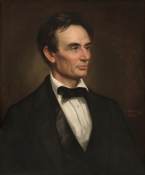 """The head and shoulders of a clean-shaven, light-skinned man with black hair and a lined face is shown against a dark background in this vertical portrait. His body is angled to our right and he looks in that direction with blue-gray eyes under black brows. His hair is combed loosely back from his face but one lock falls onto his forehead and it curls around the ear we can see. His prominent cheekbones are lightly flushed over hollow cheeks, which create noticeable shadows. He has a long nose and his thin pink lips are closed. His forehead, the corners of his eyes, and the areas around his mouth and chin are lined with wrinkles. His black suit jacket has wide rounded lapels over a white buttoned shirt. The collar folds over a black bow tie and the two buttons visible on this shirt shine. Next to his left shoulder, on our right, the artist signed and dated the work with red paint: """"G.P.A. Healy 1860."""""""