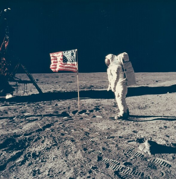 Buzz Aldrin Poses with Flag
