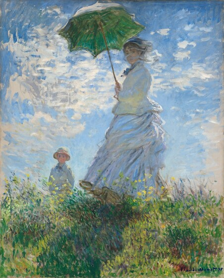 "As if situated low on a hillside, we seem to look up at a light-skinned woman and boy standing in tall grass against a sunny blue sky in this vertical painting. The woman stands at the center of the composition, and the moss green parasol she holds over her head almost brushes the top edge of the canvas. Her body faces our left but she turns her head to look at us. Her long dress is painted largely with strokes of pale blue and gray with a few touches of yellow, but we read it as being white. Her voluminous skirts swirl around her legs to our left. She holds the parasol with both hands and her brown hair is covered with a hat. Long strokes of white paint across her face suggest a veil fluttering in the breeze. The tall grass she stands in is dotted with buttercup yellow and deep mauve, and she casts a long diagonal shadow along the grass towards us. The young boy seems to stand on the other side of the hill, since the grass and flowers comes up to his waist. He wears a white jacket and pale yellow straw hat. His arms are by his sides and he seems to look off into the distance to our left. A sunny blue sky behind the figures is dotted with bright blue clouds. The painting is created with loose brushstrokes throughout, but especially choppy brushstrokes in the sky and clouds suggest wind and movement. The artist signed and dated the painting in royal blue letters at the lower right: ""Claude Monet 75."""