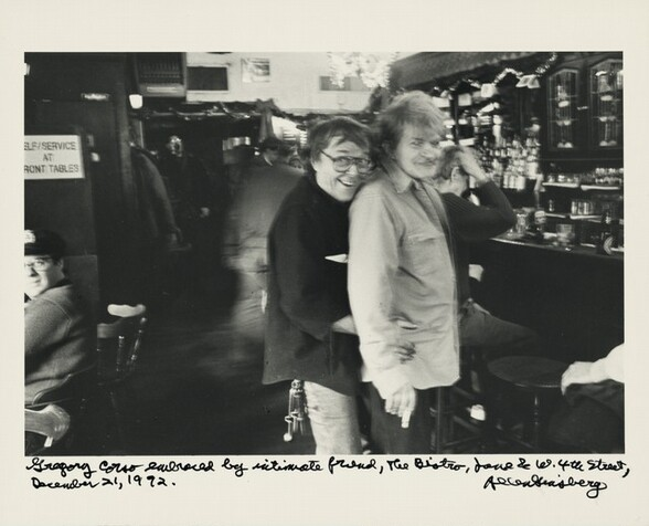 Gregory Corso embraced by intimate friend, The Bistro, Jane & W. 4th Street, December 21, 1992.
