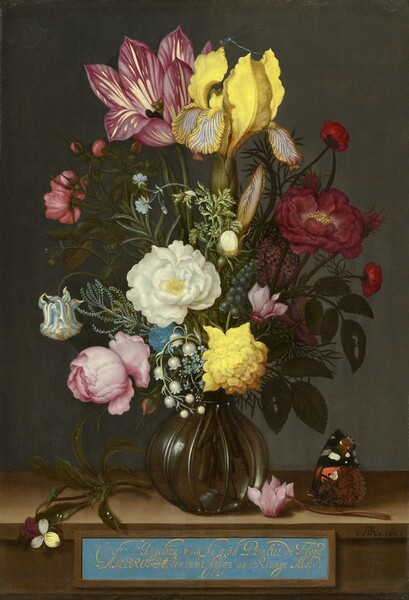 """Gathered in a round glass vase, a tall bouquet of flowers in shades of light and deep pinks, sunshine yellow, and white with pine green leaves nearly fill this vertical still life painting. Shown against an elephant gray background, the vase sits on a narrow ledge, perhaps made of wood. A label with looping, cursive French text painted in gold against a baby blue background is affixed to the front of the ledge, along the bottom edge of the composition. A few of the flowers draw the eye, including a tulip and iris at the apex of the bouquet. To our left, the tulip is mauve with cream-colored streaks, and one petal folds down to reveal the stamen inside. Next to it, a damselfly, an insect like a delicate dragonfly, rests on the vibrant yellow iris. The petals curling down from the iris are veined in muted burgundy. Flowers filling in the bouquet below include a shell pink cyclamen, a white gardenia, a closed blue-and-white-striped columbine, a slate blue grape hyacinth, a sprig of lily of the valley, pale blue forget-me-nots, and a pink peony interspersed with leaves and greenery. The round glass vase has a narrow opening. A sprig of viola rests to our left of the vase on the ledge and an orange, black, white, and brown butterfly perches on the stem of a pink cyclamen laying to our right of the vase. The French text centered below the vase reads, """"C"""