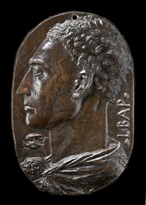 "This bronze oval medallion shows the profile of a man facing our left, his head and neck filling the space. He has short wavy hair and a long, pointed nose. He looks steadily into the distance to our left and his lips are closed. His garment wraps around the back of his neck and is knotted at the base of his throat. The capital letters ""L BAP"" run vertically up near the edge of the medallion in the space behind his neck to our right. A symbol under his chin to our left is made up of a wing arched over a stylized eye. Light glints on the deep brown bronze surface, especially on the front of the chin, cheeks, and forehead, and in his choppy hair."