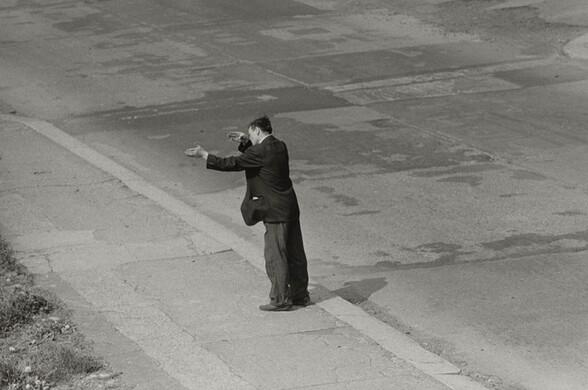 Man Gesturing in the Street