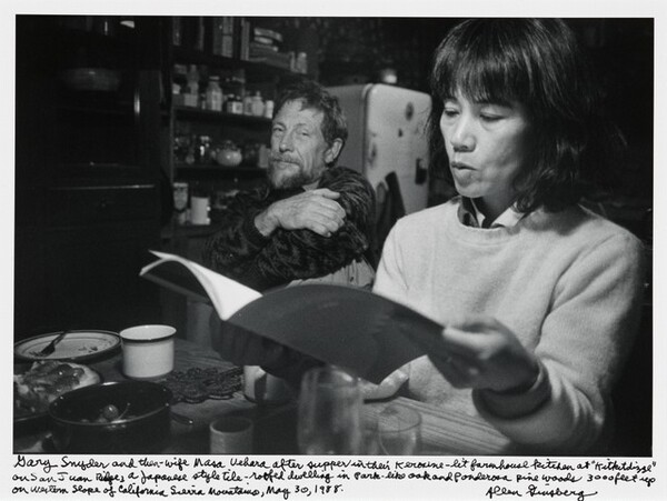 """Gary Snyder and then-wife Masa Uehara after supper in the Kerosene-lit farmhouse kitchen at """"Kitkitdizze"""" on San Juan Ridge, a Japanese style tile-roofed dwelling in park-like oak and Ponderosa pine woods 3000 feet up on Western slope of California Sierra Mountains, May 30, 1988."""
