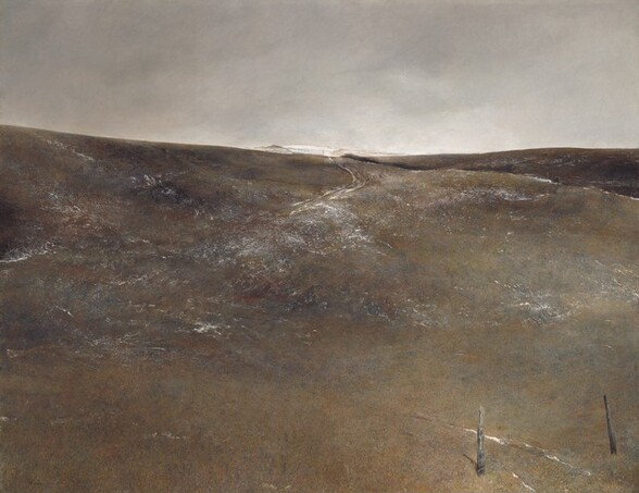 """We seem to stand near the foot of a hill sloping gently up and away from us, painted with a few streaks of white amid a field of earthy ash gray, fawn and rust browns, and muted olive-green in this horizontal landscape painting. The horizon comes about two-thirds of the way up the composition, and the sky above deepens from icy white to our right to smokey gray to our left. Short, vertical brushstrokes along the bottom edge of the panel, seeming closest to us, create the impression of scrubby ground cover. Between two splintered, worn posts near the lower right corner, snow has fallen in two lines that suggest former wagon tracks that quickly even out, though they reemerge, also lined with snow, near the crest of this low hill. More snow is sparsely scattered across the rise of the hill. A second hill, slightly darker in color, rises beyond the one in front of us to our right. Even farther away, another hill is covered in snow. The artist signed the work in black paint in the lower left corner: """"Andrew Wyeth."""""""